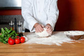 Chef preparing pizza base, cropped image — Stock Photo