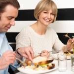 Couple enjoying delicious breakfast — Stock Photo