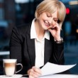 Stock Photo: Female reviewing business report in cafe