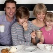 Family of four having great time in restaurant — Stock Photo #39847341