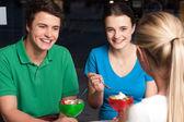 Friends enjoying meal outdoors — Stock Photo