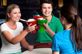 Three friends raises ice cream cup — Stock Photo