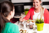 Happy young girls enjoying their dinner — Stock Photo