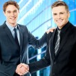 Stock Photo: Business handshake, young entrepreneurs