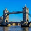 Stock Photo: Tower Bridge in London crosses River Thames