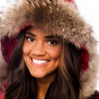 Attractive girl in fur hood — Stock Photo