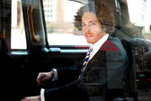 Smart business executive inside taxi cab — Foto Stock