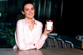 Pretty lady enjoying chilled liquid at refreshment — Stock Photo