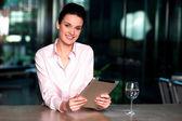 Corporate lady browsing on tablet pc — Stock Photo