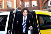 Male passanger getting out of a taxi cab — Stock Photo