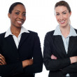 Happy businesswomen with arms crossed — Stock Photo #40898045