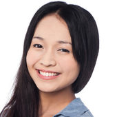 Young smiling chinese woman posing casually — Stock Photo