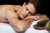 Handsome man relaxing at the spa — Stock Photo