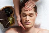 Masseuse doing facial massage — Stock Photo