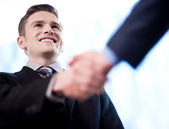 Businessman handshake — Stock Photo