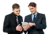 Smiling young businessmen — Stock Photo