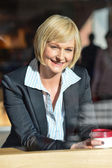 Businesswoman in an open restaurant — 图库照片