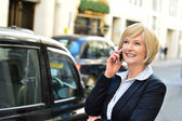 Woman attending a business call — Foto de Stock