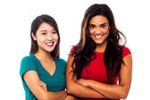 Pretty girls posing with arms crossed — Stock Photo