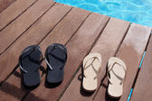 Flip flops by the swimming pool — Stock Photo