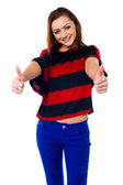 Trendy girl thumbs up — Stock Photo