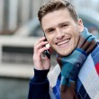 Handsome man using his mobile at outdoors — Stock Photo #44785197