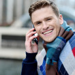 Handsome man using his mobile at outdoors — Stock Photo