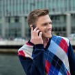 Young man talking on the cell phone — Stock Photo