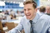 Smiling corporate man at restaurant — Stock Photo