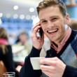 Young man using mobile phone in cafe — Stock Photo #45013989