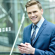 Businessman using his mobile phone — Stock Photo