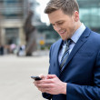 Young businessman using his mobile phone — Stock Photo #45014289