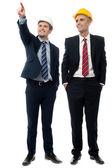 Two men in hard hats looking away — Stock Photo
