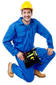 Seated construction worker posing with a smile — Stock Photo