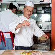 Chef busy in process of preparing pizza — Stock Photo