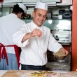 Chef busy in process of preparing pizza — Stockfoto