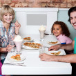 Family eating together in a restaurant — Stock Photo #46190667