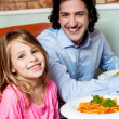 Little girl with her father in restaurant — Stock Photo #46190705