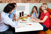 Happy family enjoying dinner — Stock Photo