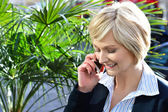 Woman using cell phone outdoors in city — Stock Photo