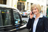 Corporate lady calling on the phone — Stock Photo