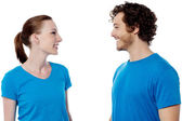 Smiling young couple in casuals — Stock Photo