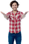 Casual young man welcoming you — Foto Stock