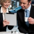 Cheerful business people using digital tablet — Stock Photo