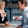 Corporate people toasting coffee at cafe — Stock Photo