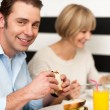 Couple enjoying delicious breakfast — Stock Photo