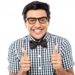 Young man showing double thumbs up — Stock Photo #49116637