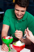 Young guy enjoying tempting dessert — Stock Photo
