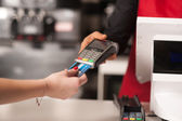 Debit card swiping on card-reader device — Stockfoto