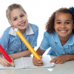 School girls doing homework together — Stock Photo #49223753
